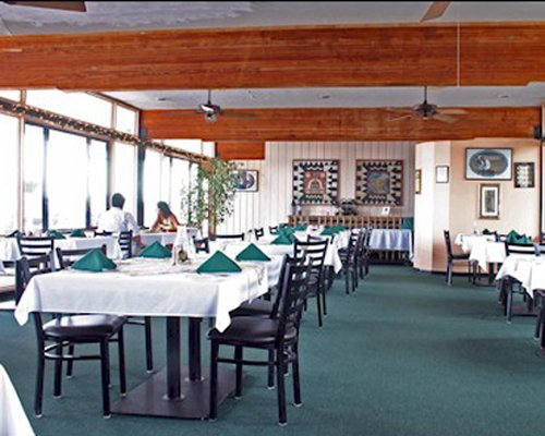 An indoor restaurant at Cedar Cove Beach and Yacht Club resort.