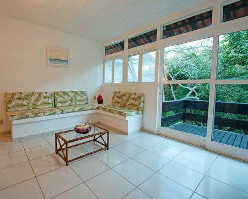 A well furnished living room with a balcony.