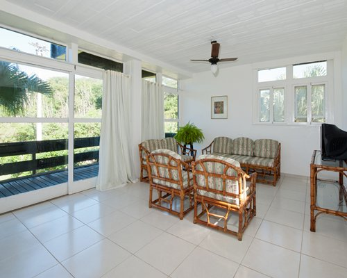 A well furnished living room with a television and outdoor view.