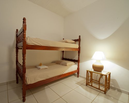 A well furnished bedroom with bunker beds.