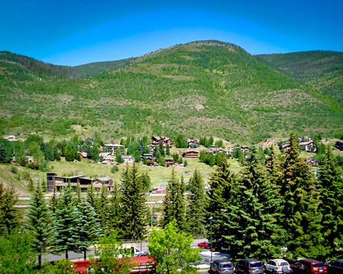 Scenic view of the Royal Holiday Stream Side At Vail Douglas resort properties surrounded by hills.