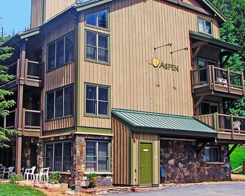 A street view of the RHC/Streamside At Vail Aspe resort with patio furniture.