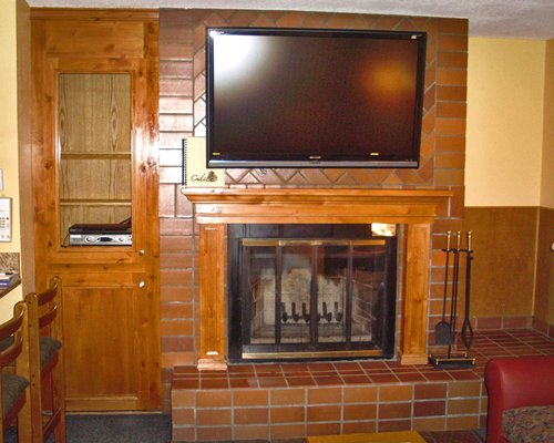 A living area with television and fireplace.