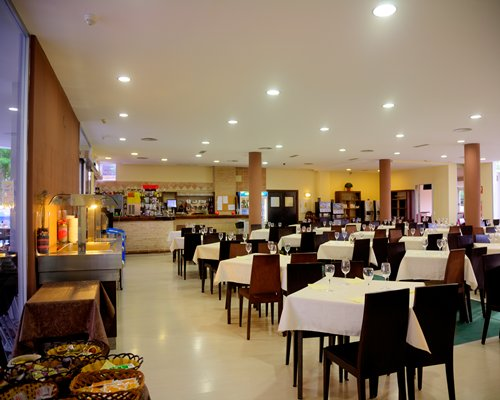 An indoor restaurant with multiple dining tables.