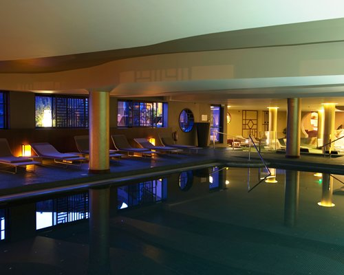 An indoor swimming pool at night.