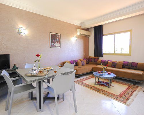 Furnished living room with open plan kitchen.