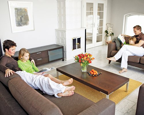A family in a well furnished living room.