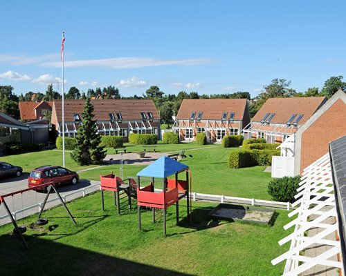 An outdoor playscape area alongside multiple resort units.