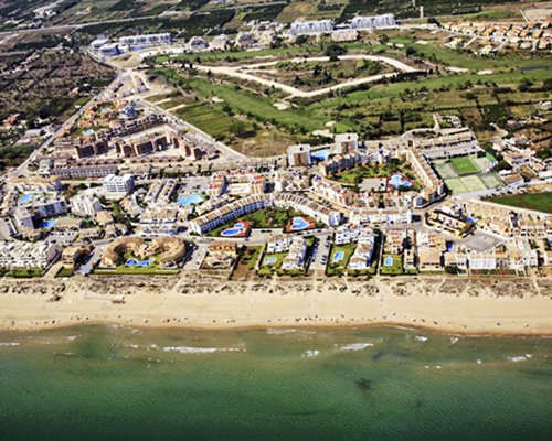 An aerial view of buildings alongside the beach.
