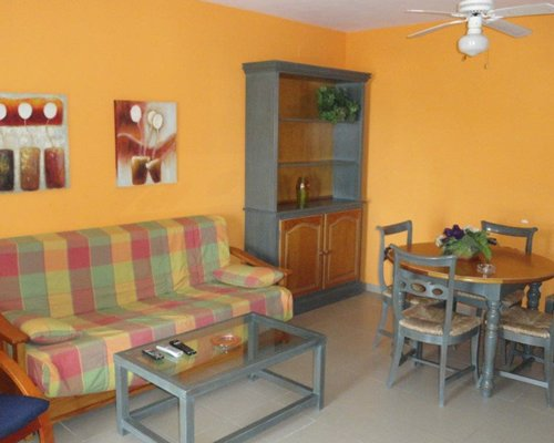 A well furnished living room with a dining area.
