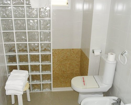 A bathroom with standing shower.