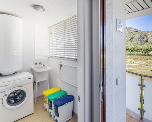 An indoor laundry room with an outside view.