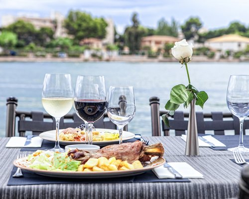 A view of food items on a table with a view of a waterfront.
