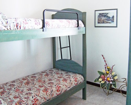 A well furnished bedroom with two bunk beds.