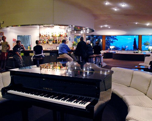 A view of an indoor bar with piano.