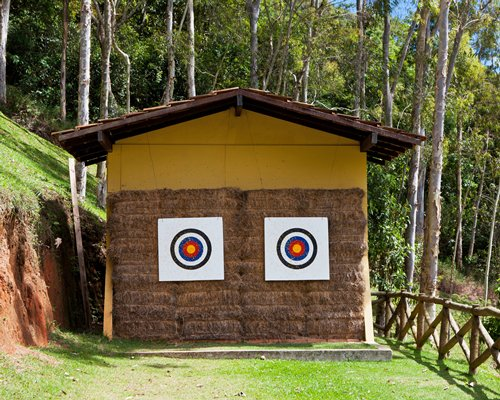 An outdoor darts play area surrounded by woods.
