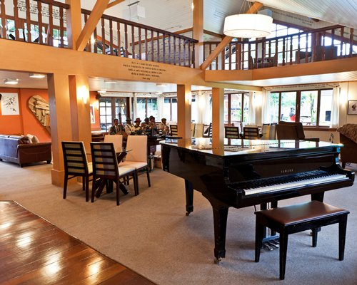 A fine dining area with a piano.