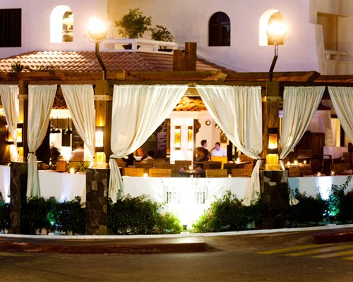 A street view of a restaurant at night.