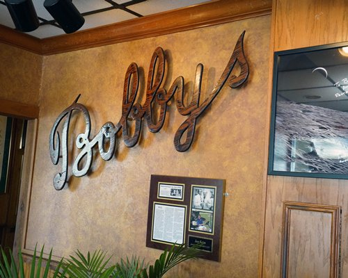Signboard of Bobbys restaurant with lounge area at The Reef Ocean Resort.