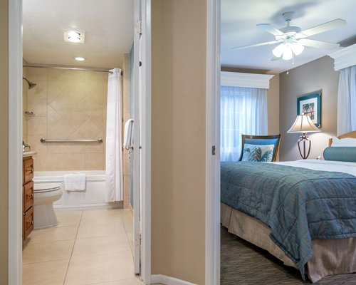 Bedroom with king bed and attached bathroom.