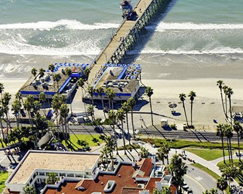 Bird eye view of San Clemente Cove resort and pier leading to the beach.