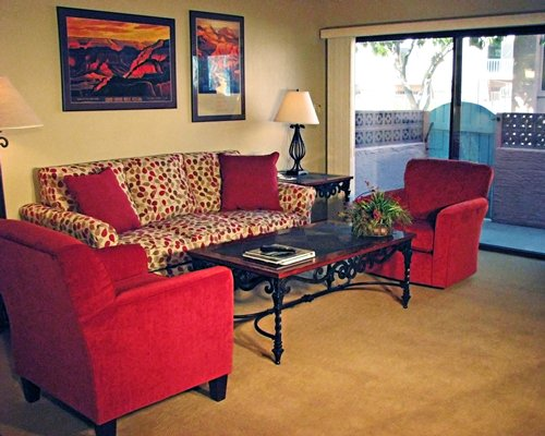 A well furnished living room with a patio.