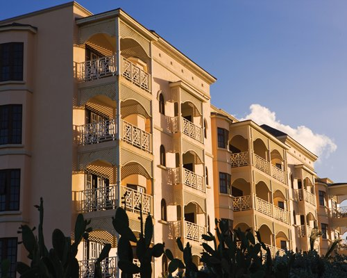 An exterior view of a multi story resort condo.