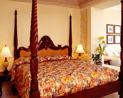 A well furnished bedroom with king bed.