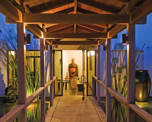 Wooden pathway leading to a unit at Crane Beach Resort.