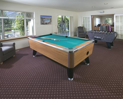 Indoor recreation area with pool table and foosball.