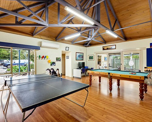 Recreational room with ping pong and a pool table.