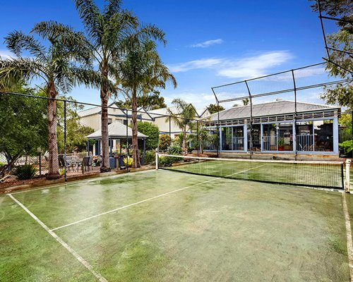 An outdoor tennis court alongside the resort.