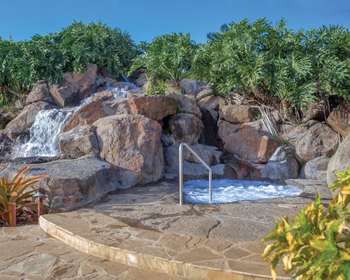 Grotto pool and outdoor hot tub.