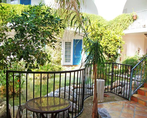 A balcony scenic landscape with patio furniture.