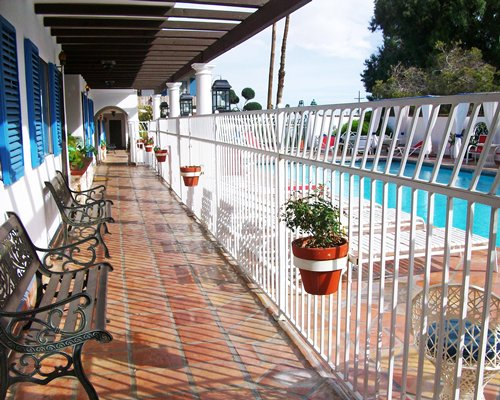 An exterior view of the patio furniture facing the swimming pool.
