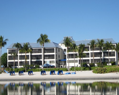 Scenic exterior view of multi story condos from the beach.