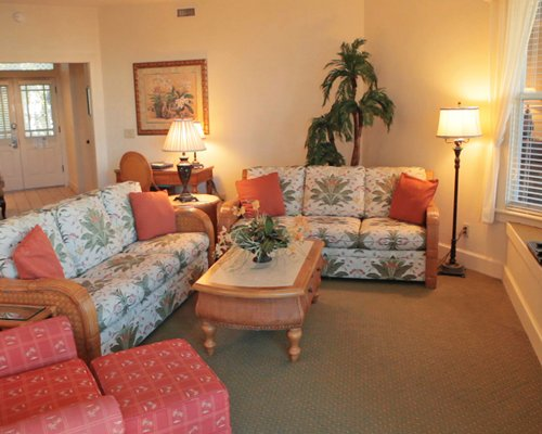 A well furnished living room with two queen pull out sofas.