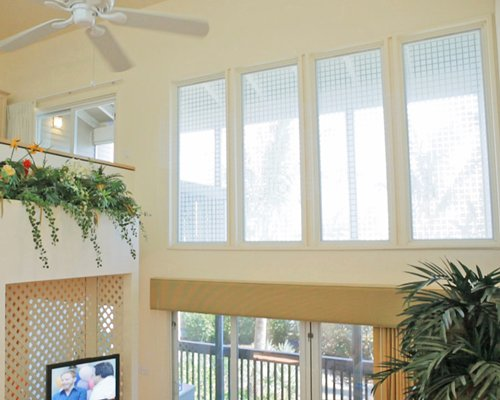 View of indoor balcony with television and outside view.