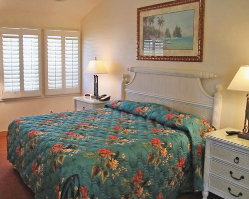 Furnished bedroom with a queen bed.