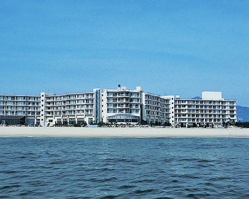 Exterior view of multi story condos from the beach.