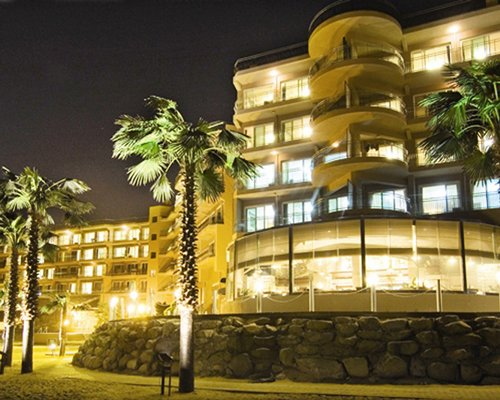 Exterior view of Kensington Resort Seorak Beach with palm trees.