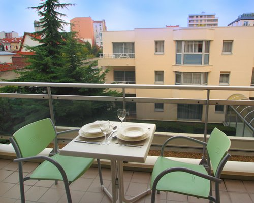 Balcony with patio furniture and view of multiple unit balconies at Royal Regency.