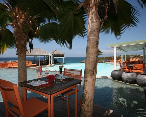 An outdoor dining area alongside the pool.