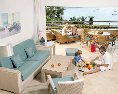 A well furnished living room with an outdoor dining area on the balcony.