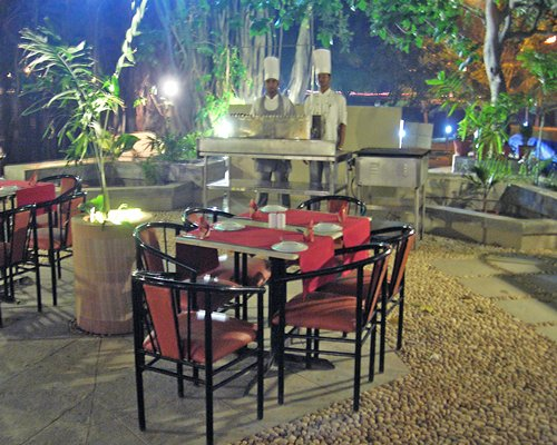 An outdoor fine dining area with buffet.