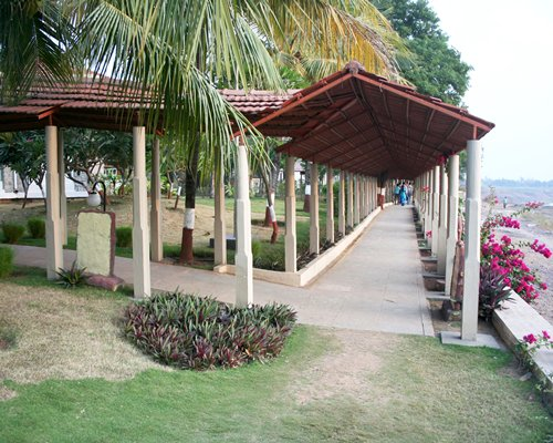 Covered pathway alongside beach.