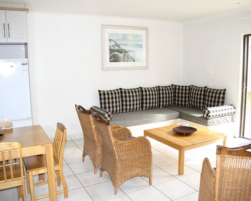 An open living room with double pullout sofa and a dining area.