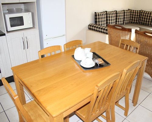 A well furnished living room with open plan kitchen and dining area.