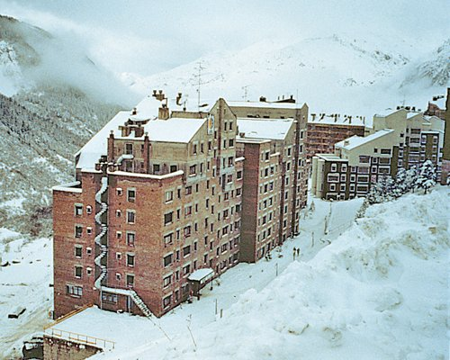 Exterior view of multiple apartment balconies at Sol Neu during winter.