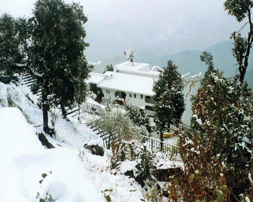 Scenic exterior view of Sterling Mussoorie during winter.